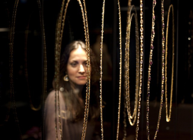 EDITORIAL USE ONLY Elpie Psalti, Museum of London exhibition project manager looks at bejeweled necklaces and chains included in the Cheapside Hoard: London's Lost Jewels Exhibition at the Museum of London, which will open to the public on Friday 11 October.  PRESS ASSOCIATION Photo. Issue date: Thursday October 10, 2013.  The extraordinary and priceless cache of nearly 500 late 16th and early 17th century jewels and gemstones - displayed in it's entirety for the first time in over 100 years - was discovered in 1912, buried in a cellar on London's Cheapside.  Photo credit should read: David Parry/PA Wire