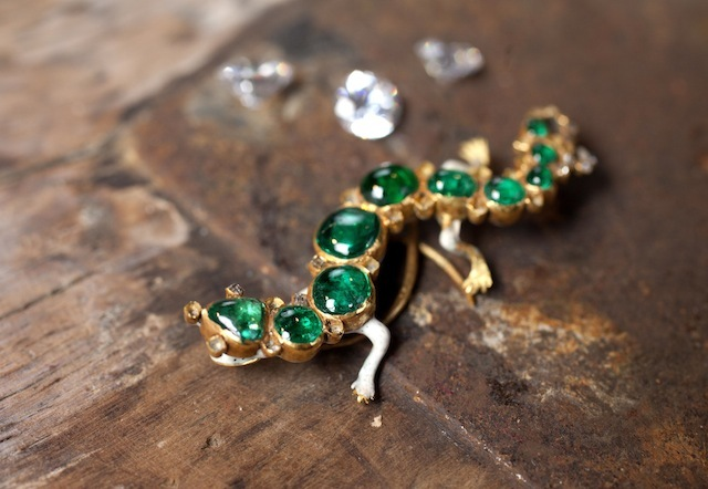 EDITORIAL USE ONLY The Salamander brooch set in gold with emeralds and diamonds, a star object included in the Cheapside Hoard: London's Lost Jewels Exhibition at the Museum of London, which will open to the public on Friday 11 October.  PRESS ASSOCIATION Photo. Issue date: Thursday October 10, 2013.  The extraordinary and priceless cache of nearly 500 late 16th and early 17th century jewels and gemstones - displayed in it's entirety for the first time in over 100 years - was discovered in 1912, buried in a cellar on London's Cheapside.  Photo credit should read: David Parry/PA Wire