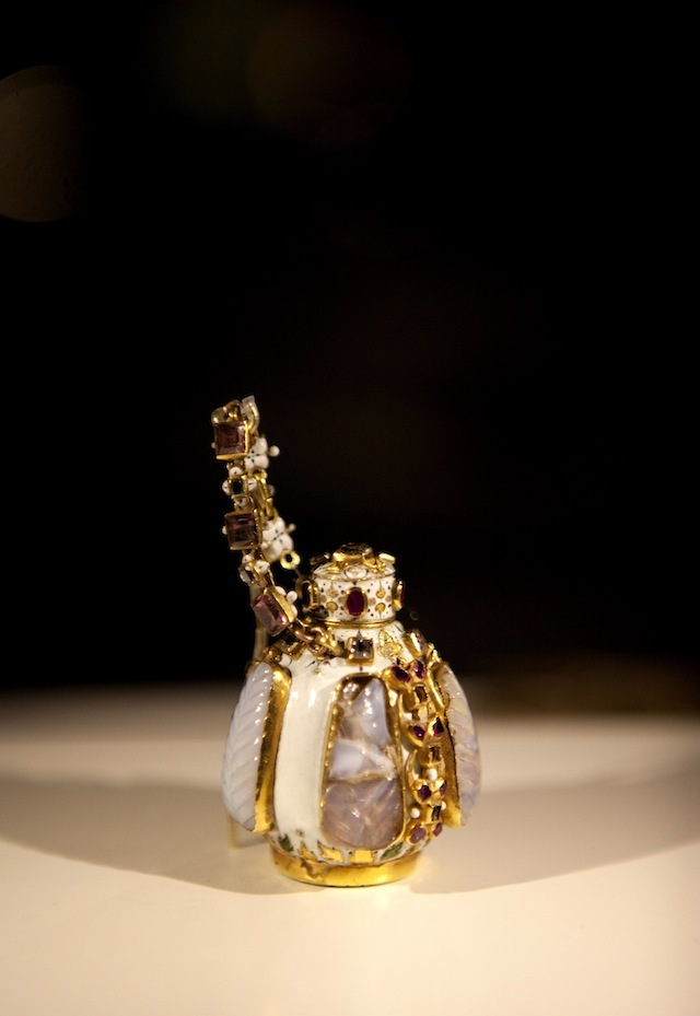 EDITORIAL USE ONLY The gold and white enamel jewelled scent bottle, an object included in the Cheapside Hoard: London's Lost Jewels Exhibition at the Museum of London, which will open to the public on Friday 11 October.  PRESS ASSOCIATION Photo. Issue date: Thursday October 10, 2013.  The extraordinary and priceless cache of nearly 500 late 16th and early 17th century jewels and gemstones - displayed in it's entirety for the first time in over 100 years - was discovered in 1912, buried in a cellar on London's Cheapside.  Photo credit should read: David Parry/PA Wire