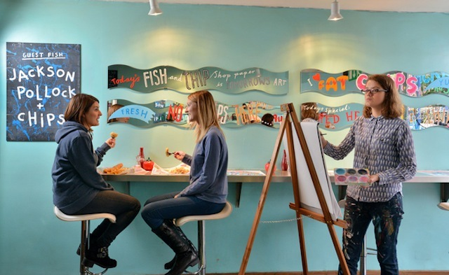 Affordable Art Fair artist Jess Wilson sketches customers as they eat at FishClub, Battersea, London as part of first ever artist-in-residence at a fish and chip shop.