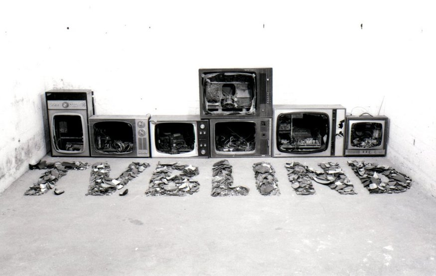 Key 15    Bill Woodrow RA  T.V. Blind, 1979  7 Televisions   89 x 160 x 352 cm   Collection of the artist