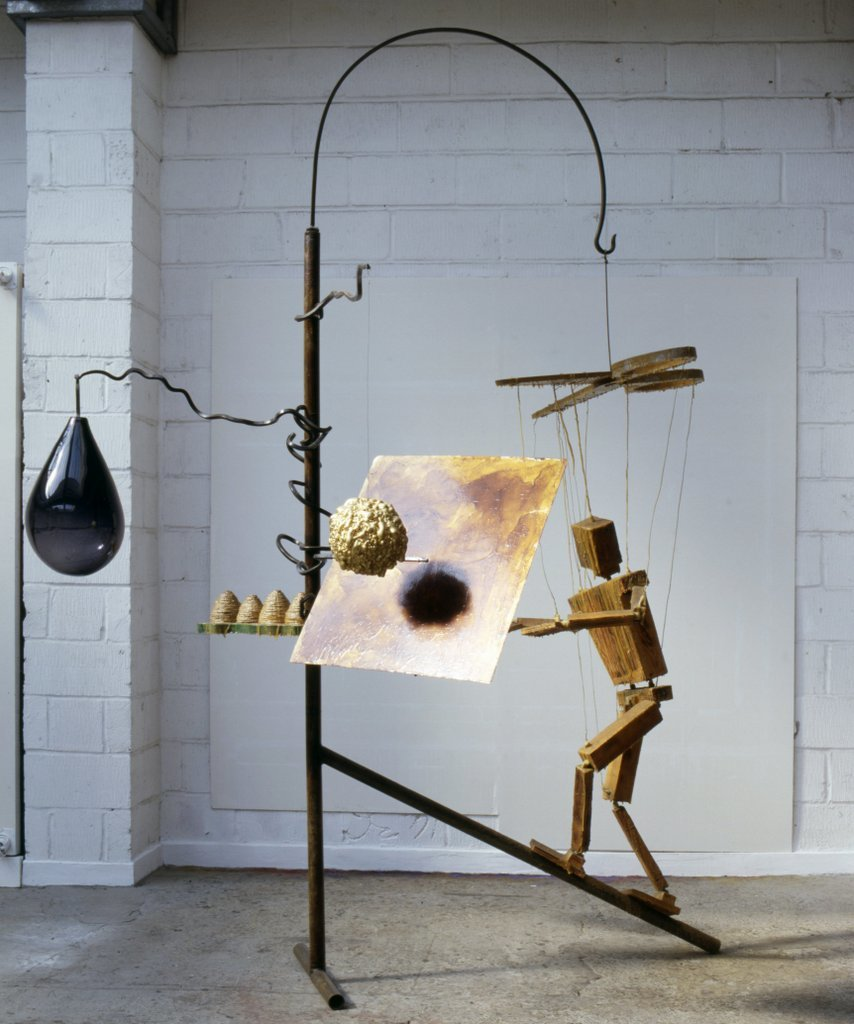 Key 31    Bill Woodrow RA  Beekeeper and Four Hives, 1997  Glass, urethane foam, wood, steel, wax, rope, gold leaf, shellac, 300 x 220 x 174 cm   Collection of the artist