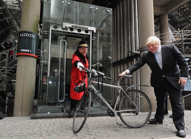 London Mayor Boris Johnson receives his bicycle from Lloyds Waiter David Hughes following a visit to Lloyd's of London as part of his engagement with the City, LLoyds, London PRESS ASSOCIATION Photo. Picture date: Monday June 24, 2013. Photo credit should read: Anthony Devlin/PA Wire