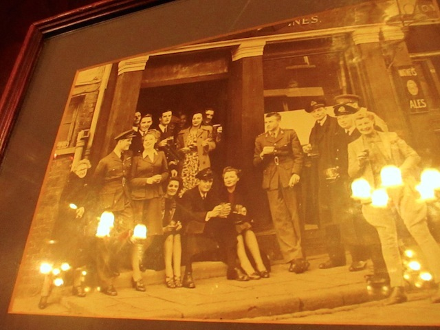 An old-times photo of the pub hangs on the wall.