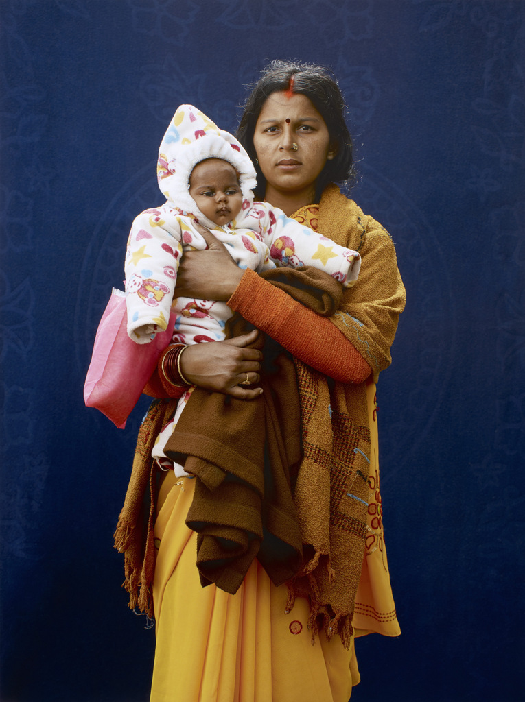 Kumbh Mela Pilgrim - Mamta Dubey and infant by Giles Price, 2013. Copyright Giles Price.