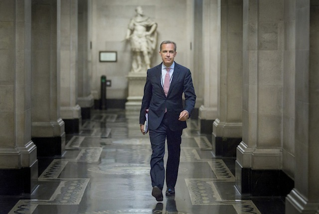 New Bank of England Governor Mark Carney walks to a monetary policy committee meeting on his first day inside the bank's City of London HQ