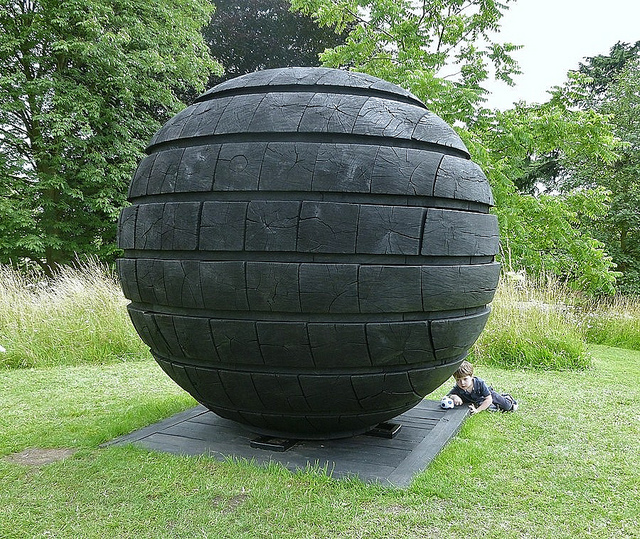 A ball by David Nash at Kew Gardens. Photo by HelenOfTheWays in the Londonist Flickr pool.