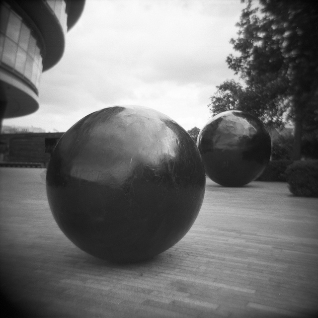 The black balls and other shapes have been hanging around City Hall since it was built. If memory serves, they're supposed to represent punctuation marks. Image by Nyaheh in the Londonist Flickr pool.