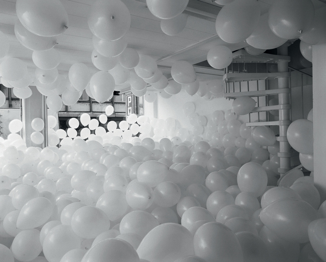 Martin Creed, Work No. 200 Half the air in a given space, 1998 White balloons, Multiple parts, each balloon 12 in / 30.5 cm diameter Overall dimensions variable    Installation at Galerie Analix B & L Polla, Geneva, Switzerland, 1998 (Detail)   Courtesy Il Giardino dei Lauri, © the artist, Image courtesy the artist