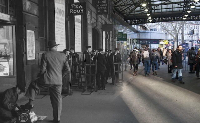 Boy shining shoes outside the Tea Room at Victoria station in 1950. A group of porters can be seen with their trolleys waiting to help travellers with their luggage.   Please note this image should only be used in the context of press publicity for the Streetmuseum app.