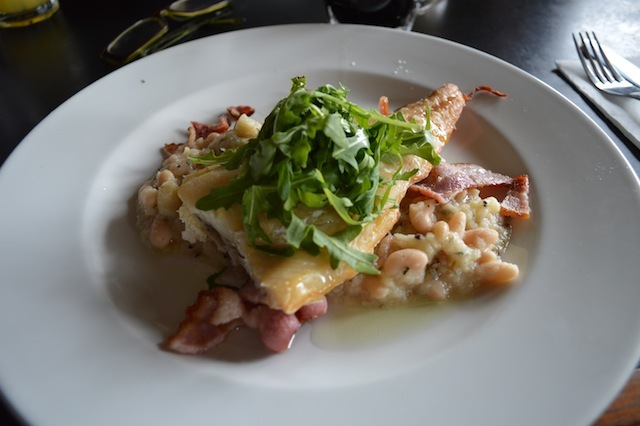 Smoked haddock with beans and bacon.