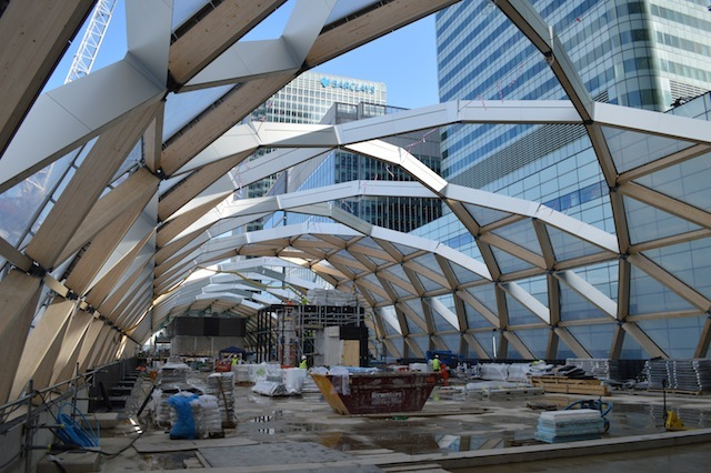 The upper level of Canary Wharf station will eventually contain plenty of greenery, including trees that will reach out through the roof. The upper levels will open around Easter 2015, providing new shops and food outlets.