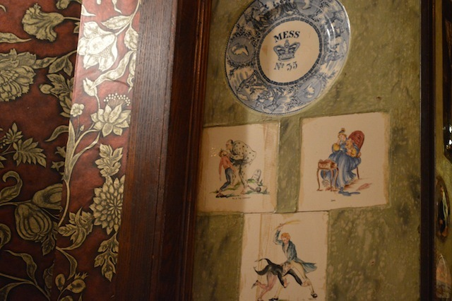 Scenes from Dickens adorn the walls.