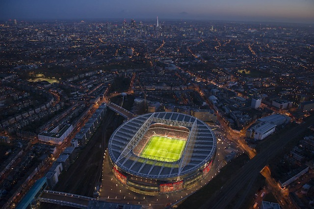 Wide view of The Emirates Stadium with City in background.