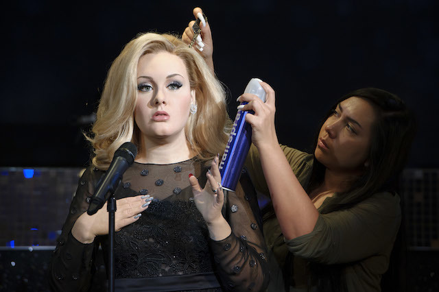 Final adjustments are made to the wax figure of British singer, Adele, by hair stylist, Gemma Sim, at Madame Tussauds, London. Wednesday, July 3, 2013.