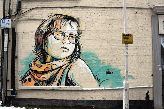 Alice Pasquini (Italy): this was the first time we painted with Alice on a street where we've put up around 15 pieces. Alice's art is always popular and this piece was no exception. It was snowing when she came over and I think the cold weather influenced her colours a lot. Sadly, the owners of the building buffed the piece out when they were repainting the rest of the wall white. White Church Lane – gone but there are plenty of other pieces still on the street.