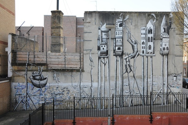 Phlegm (UK): this was the first wall we organised. The owners of the Rag Factory are sympathetic friends and art lovers so they were happy to give us their wall; we used to organise festivals there. Phlegm came down from Sheffield and painted the piece over three sunny days on a very big ladder. The wall was blank before, save for a little messy graffiti some kids had put up. The mural lifts the whole corner and turned the space from a boring alleyway into a popular stop for the street art tours. 16 Heneage Street – far wall of the Rag Factory – still there.