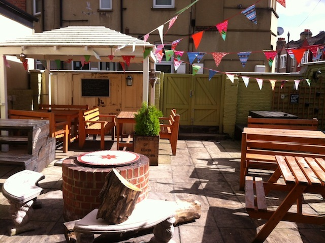 'Secret' beer garden. Note the cherry bakewell thing actually reckons to be a 'fire pit'. Blimey.