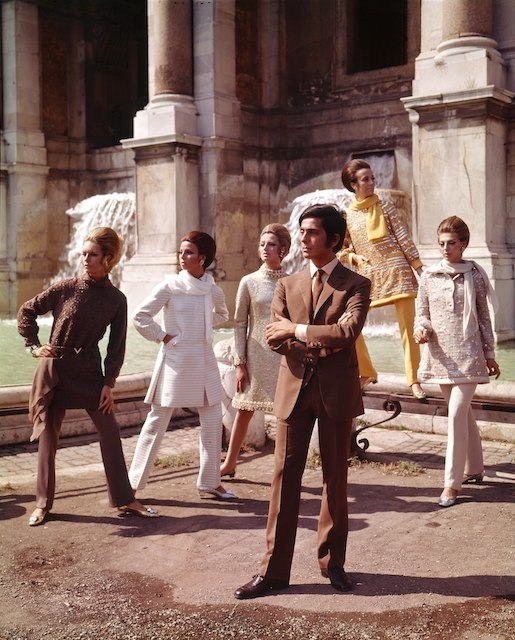 The Italian stylist Valentino posing among his models nearby Trevi Fountain. Rome, July 1967 | Photo Credit: [ The Art Archive / Mondadori Portfolio / Marisa Rastellini  ]