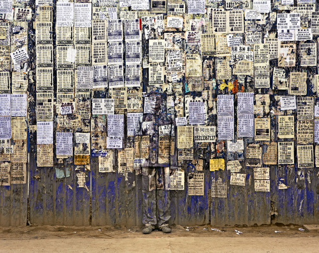 Liu Bolin, Hiding in the city - info wall. Image courtesy of the artist and Scream