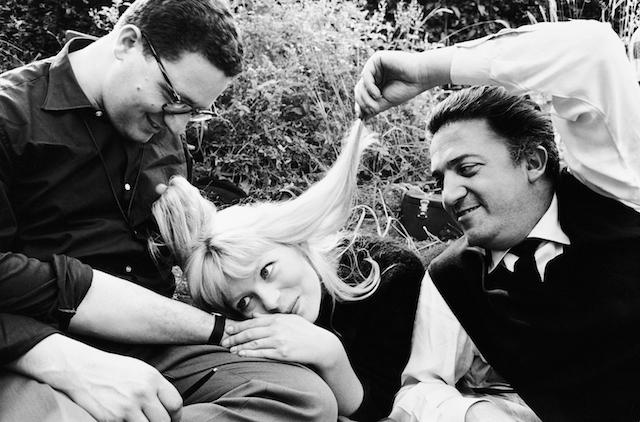 Set of 'La Dolce Vita'. Assistant cameraman Ennio Guarnieri, Nico Otzak and Federico Fellini, 1960, by Arturo Zavattini. Solares Fondazione delle Arti.