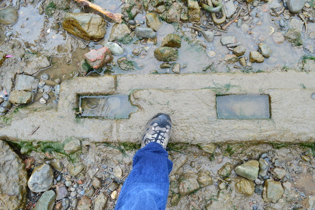 Part of a ship's keel, commonly left on the foreshore to support boats at low tide.