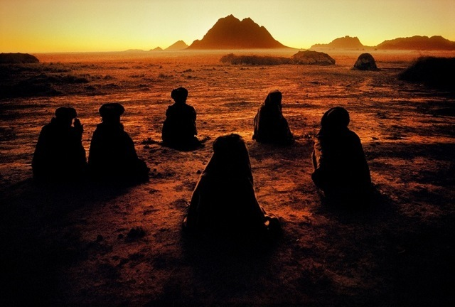 Steve McCurry, Kuchi Nomads at Prayer, 1992. Image courtesy the artist and Beetles + Huxley