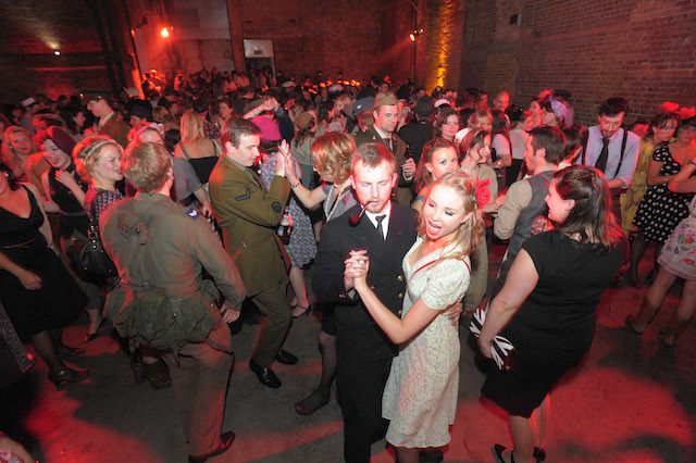 'Run For Shelter a night of Forties Fashion and Frolics On 65th Anniversary of D-Day'   Coinciding with the 65th anniversary of D-Day, 6th June Blitz Party event under the railway arches in Shoreditch,  [54 Holywell Lane , Ec2 ] remembering and honouring Britain's finest with 1940s music and dancing.    The Blitz Party gives party goers the opportunity to step back in time at our 1940s East End air raid shelter, where drinks, dancing and neighbourly spirit are the order of the evening.    Dress code: 1940's glam, home front utility clothing and allied uniform   The venue transformed into a wartime East End air raid shelter; c/w :  with sand bags, searchlights, blackout curtains, oil lamps & ration books replace bar menus and scarce provisions line the walls. The perfect setting to enjoy 1940s entertainment, including the UK's finest swing bands, performers and DJs, drink tasty cocktails and dance the night away.    www.theblitzparty.com  part of the Bourne & Hollingsworth Group  pics and copyright Nick Cunard commission The London Lite