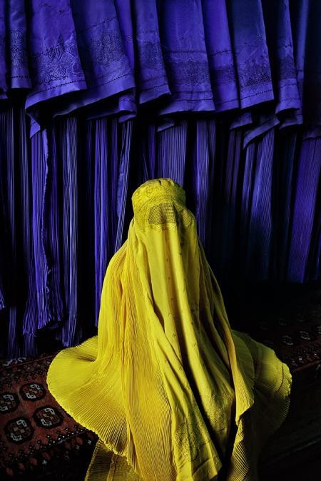 Steve McCurry, Woman in Canary Burqa. Image courtesy the artist and Beetles + Huxley