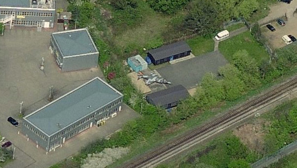 Tolworth in the Borough of Kingston harbours its own Harrier Jumpjet, pictured here in Bing Maps. It's located at the 1034 (Surbiton) Squadron Air Cadets base.