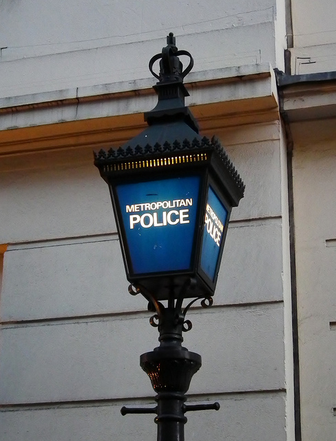 Blue lamp outside Charing Cross Police Station, by Ken