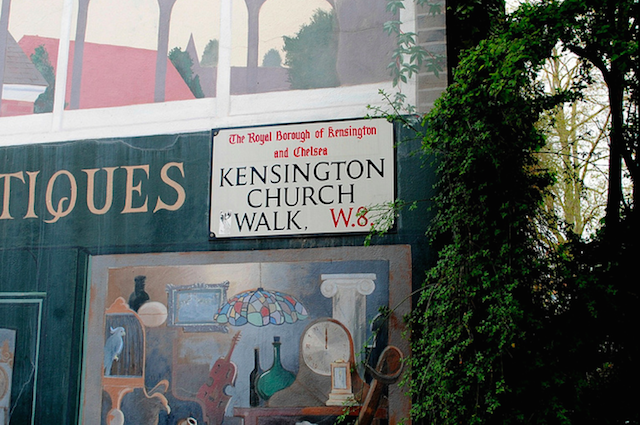 A back walk of Kensington, the street sign shadowed by a mural. Image: HoosierSands