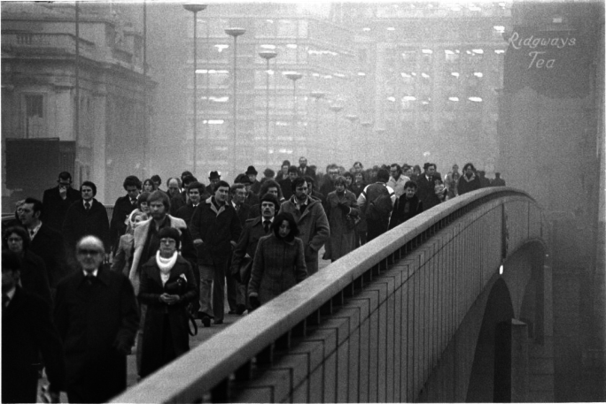 Barry Lewis. London Bridge. The new London Bridge, which opened in 1973, had heated pavements that  prevented ice from forming during the winter. British Rail opened a new London  Bridge Station in December of that year. This photo, by Barry Lewis, was part of a  Museum of London commission that documented commuting Londoners.  © Barry Lewis/Museum of London
