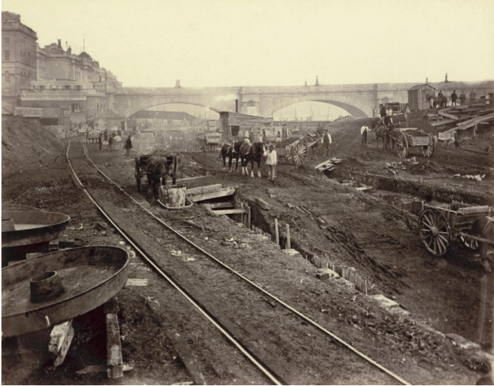 Henry Flather. The Construction of the Metropolitan District Railway 1868. Waterloo Bridge appears stranded in Flather's extraordinary photograph, almost as if  it has been thrown up during the excavations. The photograph was taken from a point west of the bridge, at the foot of Savoy Street, during the construction of the Metropolitan District Railway and Victoria Embankment. This is one of 64  photographs taken in the late 1860s by Flather to document the project. © Henry Flather/Museum of London