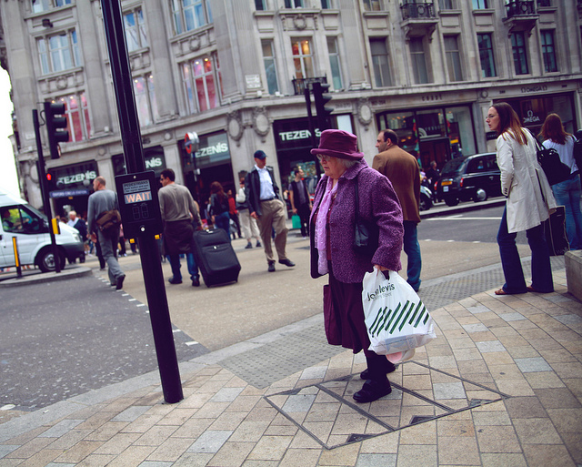 Lady in purple on Oxford Street, by Pierre Mallien