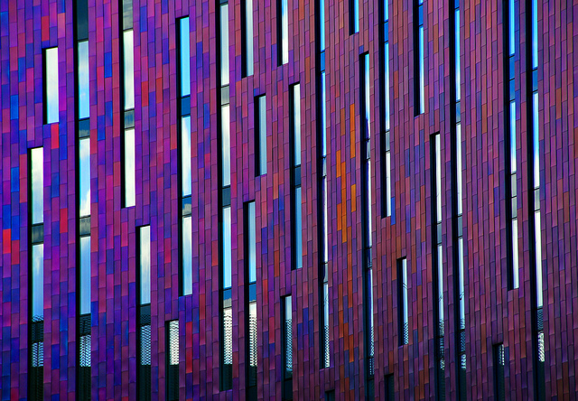 Purple mixes with blue and red on the exterior of a hotel at ExCel, by Richard Watkins LPRS