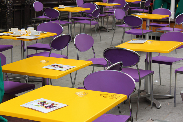 Café with yellow and purple furniture, by GediUK