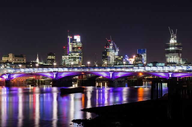 Blackfriars Bridge illuminated in purple, by Sascha Hauser