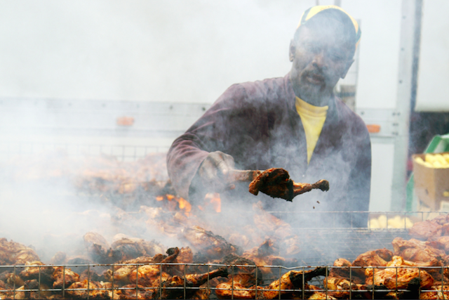 Jerk chicken being cooked at Rise Festival in Finsbury Park, by Dario
