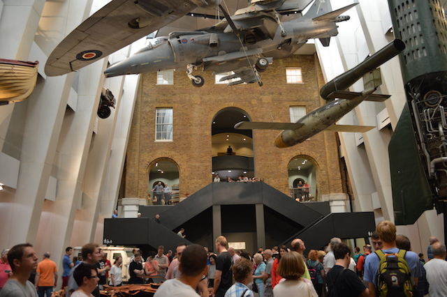 Civilians crowd around the atrium exhibits. The queue for the First World War Galleries doesn't help matters.