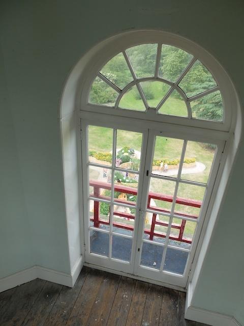 Viewing of The Healing Giant through a Pagoda window