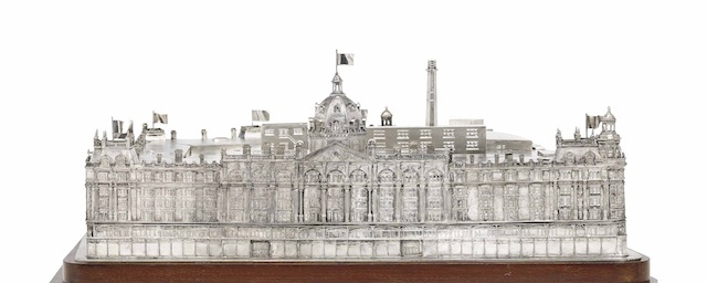The Harrods-Selfridge Wager Prize. A George V silver cigar box in the form of an architectural model of Harrods department store. (Estimate £70,000-£100,000)