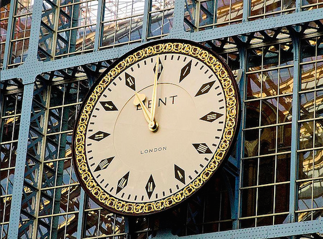 The Dent clock in St Pancras station came to be quite aptly named; the current clock is a replica of the original, which was sold to an American for a lot of money in the 1980s. In the process of lifting it down for the sale, it was dropped and smashed. The buyer clearly wasn't a fan of jigsaw puzzles as he backed out of the sale, and a retiring train driver from Nottinghamshire bought it for £25, put the pieces back together and hung it on the side of his barn, where it remains to this day, to the best of our knowledge. Dent the clockmakers were commissioned to make a replacement, so they tracked down the original, and created a new one, a close replica. That new one can be seen in St Pancras station today.