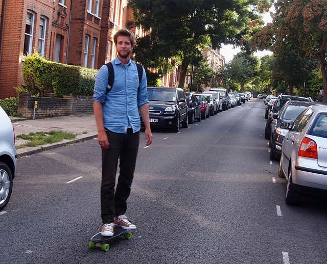 Chris Besseling skateboarding to work