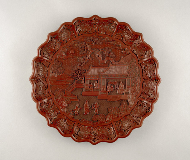Carved red lacquer on wood core, Yongle mark and period 1403-24, South China. Diameter 34.8 cm © The Trustees of the British Museum
