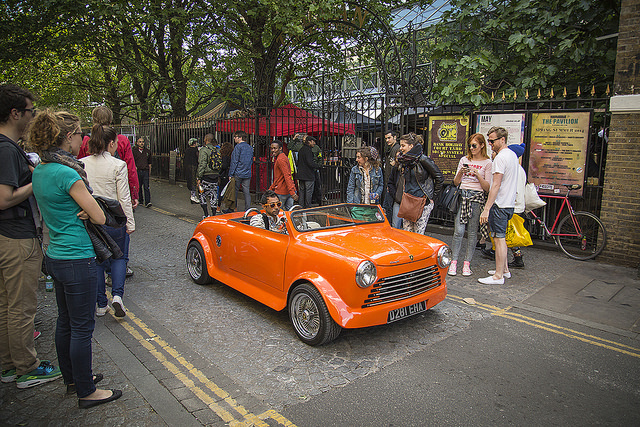 Orange car, by Michael Goldrei