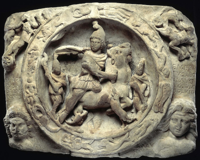 Relief sculpture of Mithras with sacrificial scene of Mithras slaying the bull. Mithras is seen here stabbing the bull from whose blood springs all earthly life. He is accompanied by the torch of bearers, Cautes and Cautopates. Signs of the zodiac and gods frame the relief. The cults of Mithras and Isis were brought to London by the Romans and gained great popularity.