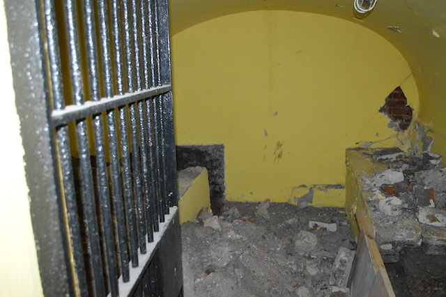 The basement of number 2 contains a strong room with iron bars and a sturdy door. It's purpose is unknown.