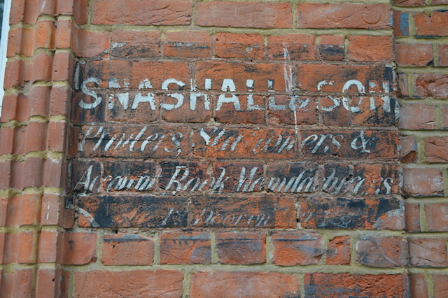 A ghost sign at the far end of Wardrobe Place.