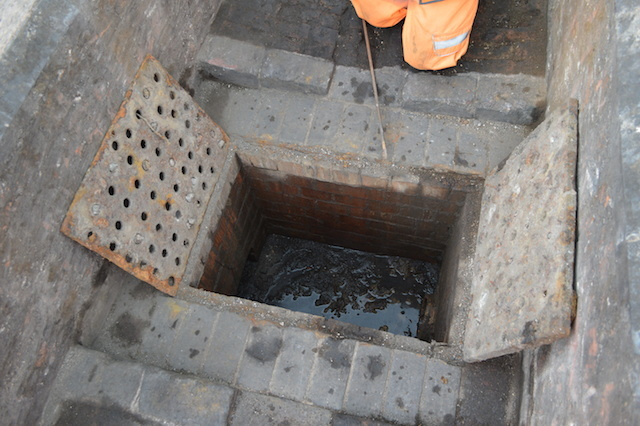 Beneath this drain hatch, a small sewer carried trackside water down to the River Westbourne.